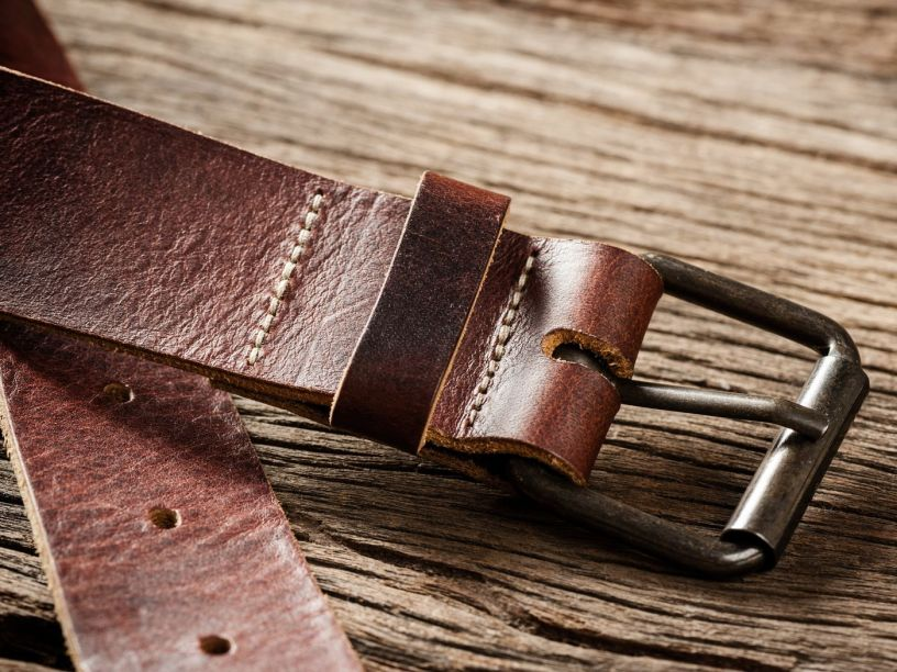 Brown belt lying on a wooden table